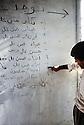 Irak 1991  Un habitant d'Halabja montrant dans une maison en ruines sur un mur les noms des habitants de cette maison, victimes des bombardements chimiques    Iraq 1991  Halabja: A list of victims of chemical bombing written on the wall of their house in ruins