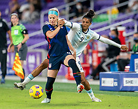 ORLANDO, FL - FEBRUARY 24: Julie Ertz #8 of the USWNT fights for the ball with Soledad Jaimes #9 of Argentina during a game between Argentina and USWNT at Exploria Stadium on February 24, 2021 in Orlando, Florida.