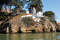 The Yerba Buena Lighthouse sits on the south side of Yerba Buena Island in San Francisco Bay. The lighthouse first became operational in 1875 and was automated in 1958. The Fifth Order Fresnal Lens in the light tower was installed in 1886 and is still operational.  The former lightkeepers house above the lighthouse now serves as a home for Coast Guard Admirals.