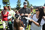 Green Bay Packers quarterback Aaron Rodgers signs autographs during a practice round at the 22nd American Century Celebrity Golf Championship at Edgewood Tahoe Golf Course in Stateline, Nev., on Thursday, July 14, 2011. (AP Photo/Cathleen Allison)