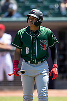 Great Lakes Loons shortstop Leonel Valera (8) walks back to the dugout after striking out on May 30, 2021 against the Lansing Lugnuts at Jackson Field in Lansing, Michigan. (Andrew Woolley/Four Seam Images)