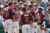 Florida State coach Mike Martin meets with his team on the mound in Game 5 of the NCAA Division One Men's College World Series on Monday June 21st, 2010 at Johnny Rosenblatt Stadium in Omaha, Nebraska.  (Photo by Andrew Woolley / Four Seam Images)