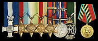 BNPS.co.uk (01202) 558833.<br /> Pic: DNW/BNPS<br /> <br /> The medals of a World War Two navy commander who survived his ship's sinking by clinging to a comrade's dead body have sold for almost £20,000.<br /> <br /> Commander Charles Cuthbertson was in charge of the HMS Zinnia when it was destroyed by a German U-Boat in the north Atlantic in 1941, sinking in 20 seconds.<br /> <br /> He grabbed hold of the trunk of a dead seaman in the water in a desperate bid to stay afloat, holding on for 30 minutes before being fished out of the sea by a passing dinghy.<br /> <br /> Cmdr Cuthbertson's tale of survival inspired Nicholas Monsarrat to write his best-selling novel 'The Cruel Sea', which was subsequently made into a 1953 film starring Jack Hawkins and Stanley Baker.
