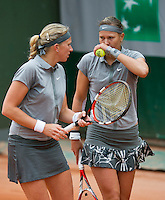 France, Paris, 28.05.2014. Tennis, French Open, Roland Garros, Michaella Krajicek (NED) and her dubbles partner Lucie Hradecka (CZE) (R)<br /> Photo:Tennisimages/Henk Koster