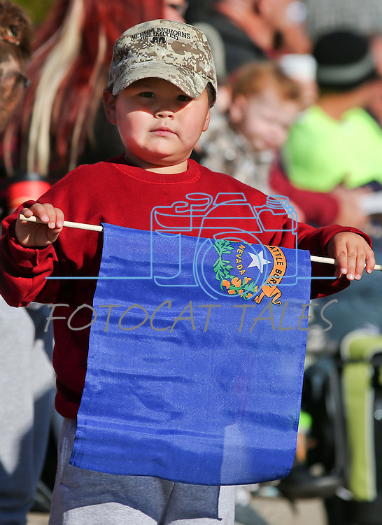Hunter Leyva, 3, of Hawthrone, waits for the start of the 75th annual Nevada Day parade in Carson City, Nev., on Saturday, Oct. 26, 2013.<br /> Photo by Cathleen Allison