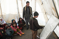 Children in the Charie Qamba refugee camp spend the day in classes organised by the Aschiana NGO and are given a hot meal. 9-1-14 The camp is home people from Helmand province who have fled fighting between NATO and the Taliban. Each winter several children from the camp die as a result of the cold weather.