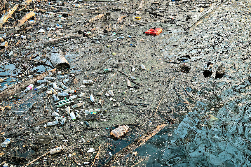 Garbage polluting a river.