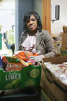 Monique Jones poses for a portrait, Saturday, February 6, 2021 at the St. James Church in Fayetteville. Jones runs the food pantry there. She's turned the food pantry into a huge effort that collaborates with other area food banks as well as other NWA churches to deliver to 11 different communities in the NWA area. Check out nwaonline.com/210207Daily/ for today's photo gallery. <br /> (NWA Democrat-Gazette/Charlie Kaijo)