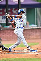 Kingsport Mets third baseman Shervyen Newton (12) swings at a pitch during a game against the Elizabethton Twins at Joe O'Brien Field on August 7, 2018 in Elizabethton, Tennessee. The Twins defeated the Mets 16-10. (Tony Farlow/Four Seam Images)