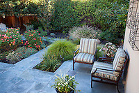 Small space back yard flag stone patio with planting pockets, Lundstrom Garden, design by Susan Morrison