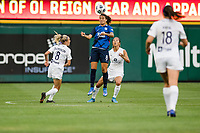 TACOMA, WA - JULY 31: Dzsenifer Marozsan #8 of the OL Reign goes up for header during a game between Racing Louisville FC and OL Reign at Cheney Stadium on July 31, 2021 in Tacoma, Washington.