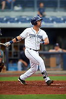 Charlotte Stone Crabs first baseman Nathaniel Lowe (7) follows through on a swing during the first game of a doubleheader against the Tampa Yankees on July 18, 2017 at Charlotte Sports Park in Port Charlotte, Florida.  Charlotte defeated Tampa 7-0 in a game that was originally started on June 29th but called to inclement weather.  (Mike Janes/Four Seam Images)