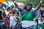 Men and women from Sierra Leone, a war-torn country in West Africa, march in the DC Caribbean Carnival parade, which is held annually in Washington, DC.  The large, Caribbean-style parade boasts dancers in traditional Caribbean carnival costumes, the festival promotes and educates the community about Caribbean arts, crafts, and culture.