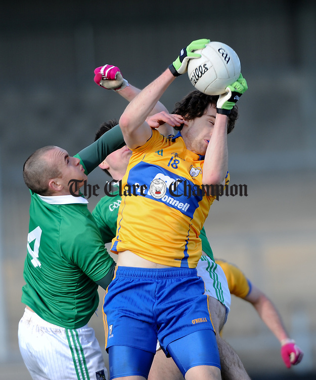 Shane Brennan of Clare in action against Steven Lavin of Limerick during their National League game at Cusack Park. Photograph by John Kelly.