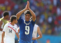Christian Bolanos of Costa Rica celebrates at full time wearing the shirt of Mario Balotelli of Italy back to front