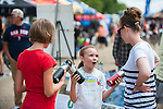 (From Right) Greta Pugh, 10, and Elsa Harrison, 11, try to sell water bottles that support The Nevada Interscholastic Cycling League during the Epic Rides' Inaugural Carson City Off-Road event on Saturday, June 18, 2016 in Carson City, Nev.<br /> Photo by Kevin Clifford/Nevada Photo Source