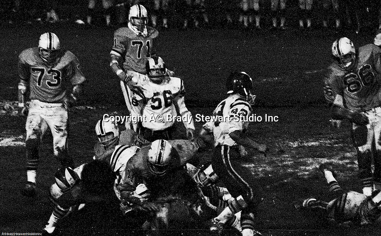 Bethel Park PA:  Defensive play with Mike Stewart 11 and Clark Miller 30 making the tackle on an Mt Lebanon running back.  Others in the photo; Jim Dingeldine 73, Glenn Eisaman 71, Dennis Franks 66.  The defense recovered 5 fumbles but the offense was not able to score against the Mt Lebanon Defense.  The field conditions were horrendous, after every play you had to get the sawdust out of your eyes. After a highly disputed non-TD call by Art Walker's brother-in-law, the undefeated Mt Lebanon Blue Devils ended up winning the Western Conference.  The defensive unit was one of the best in Bethel Park history only allowing a little over 7 points a game.