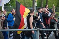 """Baergida Montagsdemonstration in Berlin.<br /> Ca. 150 Anhaenger des Berliner Pegida-Ablegers """"Baergida"""" zogen mit einer Demonstration vom Hauptbahnhof zum Roten Rathaus. Unter den Teilnehmern waren wie immer etwa 30-35 Fussball-Hooligans, sog. """"Reichsbuerger"""", Verschwoerungstheoretiker und Rechtsradikale. Die Demonstranten riefen immer wieder Parolen wie gegen anwesende Journalisten und gegen die Bundesregierung. Ein Journalist, der in der Vorwoche von Baergida-Anhaengern verpruegelt und verletzt wurde, wurde erneut verbal bedroht.<br /> 4.5.2015, Berlin<br /> Copyright: Christian-Ditsch.de<br /> [Inhaltsveraendernde Manipulation des Fotos nur nach ausdruecklicher Genehmigung des Fotografen. Vereinbarungen ueber Abtretung von Persoenlichkeitsrechten/Model Release der abgebildeten Person/Personen liegen nicht vor. NO MODEL RELEASE! Nur fuer Redaktionelle Zwecke. Don't publish without copyright Christian-Ditsch.de, Veroeffentlichung nur mit Fotografennennung, sowie gegen Honorar, MwSt. und Beleg. Konto: I N G - D i B a, IBAN DE58500105175400192269, BIC INGDDEFFXXX, Kontakt: post@christian-ditsch.de<br /> Bei der Bearbeitung der Dateiinformationen darf die Urheberkennzeichnung in den EXIF- und  IPTC-Daten nicht entfernt werden, diese sind in digitalen Medien nach §95c UrhG rechtlich geschuetzt. Der Urhebervermerk wird gemaess §13 UrhG verlangt.]"""