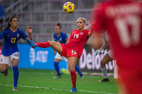 ORLANDO, FL - FEBRUARY 24: Adriana Leon #19 of the CANWNT kicks  the ball during a game between Brazil and Canada at Exploria Stadium on February 24, 2021 in Orlando, Florida.