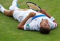 14-06-11, Tennis, Rosmalen, Unicef Open, Jesse Huta Galunggaat onderuit maar wint zijn partij tegen Reister