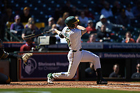 Mack Mueller (50) of the Baylor Bears follows through on his swing against the Missouri Tigers in game one of the 2020 Shriners Hospitals for Children College Classic at Minute Maid Park on February 28, 2020 in Houston, Texas. The Bears defeated the Tigers 4-2. (Brian Westerholt/Four Seam Images)