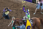 DEL MAR, CA - NOVEMBER 04: Jose Ortiz, aboard Good Magic #6, tosses flowers into the air after his win on Day 2 of the 2017 Breeders' Cup World Championships at Del Mar Thoroughbred Club on November 4, 2017 in Del Mar, California. (Photo by Ting Shen/Eclipse Sportswire/Breeders Cup)