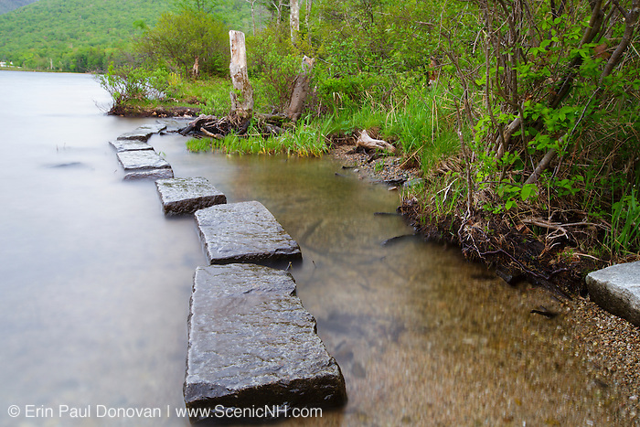 Foot path on the edge of Echo Lake during the spring months in Franconia Notch State Park of the New Hampshire White Mountains.