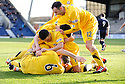 EDDIE MALONE IS MOBBED BY HIS TEAM MATES AFTER HE SCORES AYR'S SECOND GOAL