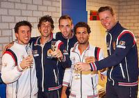 07-04-12, Netherlands, Amsterdam, Tennis, Daviscup, Netherlands-Rumania, Het winnende team, v.l.n.r.:, Igor Sijsling ,Robin Haase, Thomas Schoorel, Jean-Julien Rojer en captain Jan Siemerink proosten op de goede afloop.