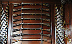"""Governor's Palace Revolutionary war musket and swords Colonial Williamsburg VIrginia, sword, swords, muskets, musket, flint lock rifles, Colonial Williamsburg Virginia is historic district 1699 to 1780 which made colonial Virgnia's Capital, for most of the 18th century Williamsburg was the center of government education and culture in Colony of Virginia, George Washington, Thomas Jefferson, Patrick Henry, James Monroe, James Madison, George Wythe, Peyton Randolph, and others molded democracy in the Commonwealth of Virginia and the United States, Motto of Colonial Williamsburg is """"The furture may learn from the past,"""""""