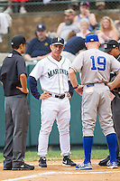 Pulaski Mariners manager Rob Mummau (3) meets with Burlington Royals manager Tommy Shields (19) prior to the game at Calfee Park on June 20, 2014 in Pulaski, Virginia.  The Mariners defeated the Royals 6-4. (Brian Westerholt/Four Seam Images)