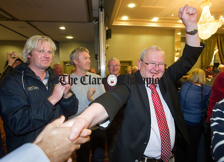 Pat Mc mahon of Fianna Fail celebrates his win during the election count at The West county Hotel, Ennis. Photograph by John Kelly.