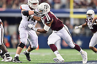 Texas A&M defensive lineman Myles Garrett (15) is tackled by Arkansas guard Brey Cook (74) during second quarter of an NCAA Football game, Saturday, September 27, 2014 in Arlington, Tex. Arkansas leads 21-14 at the halftime. (Mo Khursheed/TFV Media via AP Images)