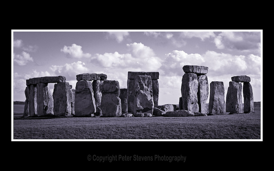 Stonehenge - Wiltshire - 6th April 2005 -<br /> <br /> Stonehenge is composed of earthworks surrounding a circular setting of large standing stones. It is at the centre of the most dense complex of Neolithic and Bronze Age monuments in England, including several hundred burial mounds. The earliest phase of the monument, have been dated to about 3100 BC. <br /> <br /> Archaeologists have found large Mesolithic postholes which date to around 8000 BC.