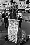 """Street preachers UK. Christian evangelical street meeting, """"Stand still and see the wondrous works of God."""" Southend on Sea, Essex, England. 1974 1970s"""