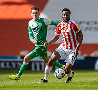 5th April 2021; Bet365 Stadium, Stoke, Staffordshire, England; English Football League Championship Football, Stoke City versus Millwall; John Obi Mikel of Stoke City breaks away from  Jed Wallace of Millwall