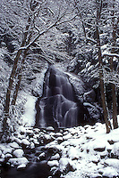 AJ5980, waterfall, river, Green Mountain National Forest, winter, wintry, snow, Moss Glen Falls cascades down over snow covered rocks on its way downstream on a wintry day in Granville Gulf Reservation in Addison County in the state of Vermont.