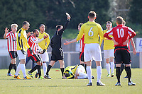 Joey May of Hornchurch (partly hidden) is sent off by referee John Hopkins - AFC Hornchurch vs Bromley - Blue Square Conference South Football at The Stadium, Upminster Bridge, Essex - 01/04/13 - MANDATORY CREDIT: Gavin Ellis/TGSPHOTO - Self billing applies where appropriate - 0845 094 6026 - contact@tgsphoto.co.uk - NO UNPAID USE.