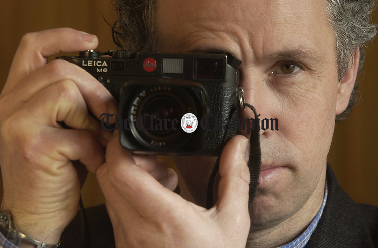Photographer Christy Mc Namara with the tool of his trade. Photograph by John Kelly.