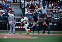 SAN FRANCISCO, CA:  Jeff Kent of the San Francisco Giants hits a game-winning double in the bottom of the 9th inning during the game against the Colorado Rockies at Pacific Bell Park in San Francisco, California on July 6, 2000. (Photo by Brad Mangin)
