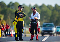 Sep 26, 2020; Gainesville, Florida, USA; NHRA top fuel driver Shawn Langdon (left) talks with Steve Torrence during qualifying for the Gatornationals at Gainesville Raceway. Mandatory Credit: Mark J. Rebilas-USA TODAY Sports