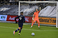 KANSAS CITY, KS - OCTOBER 24: #9 Alan Pulido of Sporting Kansas City drives toward goal as #50 William Yarbrough of the Colorado Rapids instructs his defense during a game between Colorado Rapids and Sporting Kansas City at Children's Mercy Park on October 24, 2020 in Kansas City, Kansas.