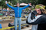 August 29, 2015 : Patrons exclaim victory after being first in line and getting prime real estate for race viewing on Travers Stakes Day at Saratoga Race Course in Saratoga Springs, NY. Scott Serio/ESW/CSM
