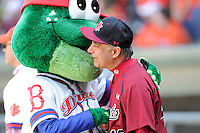 Greenville Drive mascot Reedy Rip'It hugs University of South Carolina President Harris Pastides before the Reedy River Rivalry game on March 1, 2014, at Fluor Field at the West End in Greenville, South Carolina. South Carolina won, 10-2. (Tom Priddy/Four Seam Images)