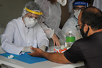 11/01/2021 - ENTREGADORES REALIZAM TESTES DE COVID EM CAMPINAS