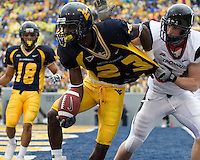 West Virginia defensive back Guesly Dervil intercepts a two-point conversion attempt by Cincinnati.  The WVU Mountaineers defeated the Cincinnati Bearcats 42-24 on November 11, 2006 at Mountaineer Field, Morgantown, West Virginia.