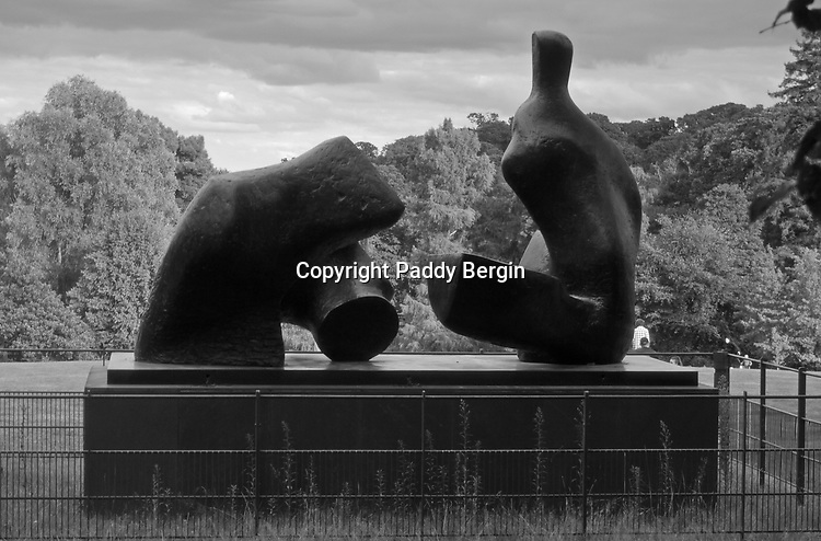 Henry Moore Two Piece Reclining Figure No.5 1963-4 situated in Kenwood Park, Hampstead, North London.<br /> <br /> Divided into two pieces that resemble boulders more than body parts, this reclining figure exemplifies Moore's interest in the coalescence of human and geological imagery. The work also demonstrates his concern with the figure in space in that relationships between forms appear to change when the sculpture is viewed in the round.<br /> <br /> Stock Photo by Paddy Bergin