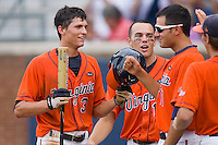 Jarrett Parker #3 of the Virginia Cavaliers celebrates with teammates after scoring a run against the Ole Miss Rebels at the Charlottesville Regional of the 2010 College World Series at Davenport Field on June 5, 2010, in Charlottesville, Virginia.  The Cavaliers defeated the Rebels 13-7.  Photo by Brian Westerholt / Four Seam Images