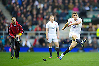 Owen Farrell of England takes a penalty kick as Mike Catt, England Attacking Skills Coach (left), and Chris Ashton of England look on during the QBE Autumn International match between England and New Zealand at Twickenham on Saturday 01 December 2012 (Photo by Rob Munro)