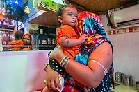 India, Maharashtra, Mumbai, Bombay, red light district. Priya, with her baby, live and work in the brothel.